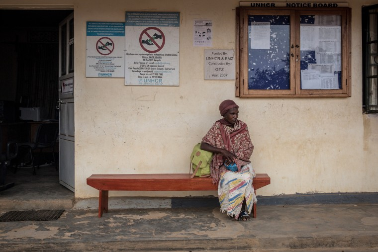 Image: A woman sits outside UNHCR's office in Nakivale refugee settlement in southwest Uganda.