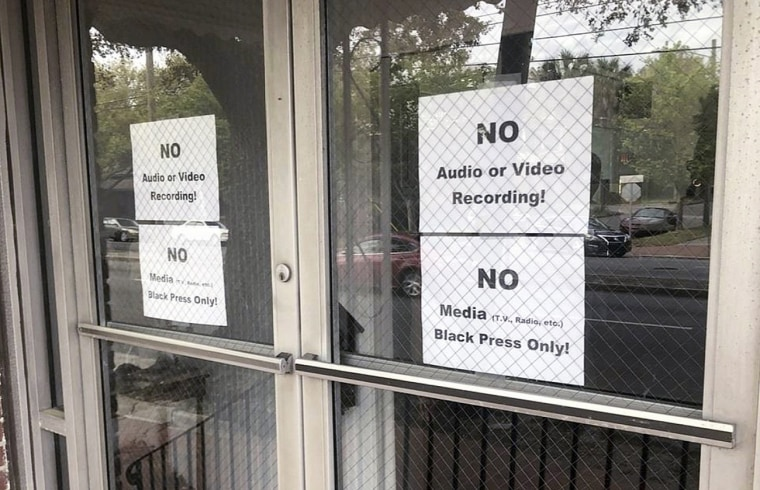 Image: Signs posted on the doors of Bolten Street Baptist Church allowing only black reporters to attend a meeting on Savannah's mayoral race in Georgia on March 27, 2019.