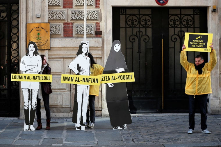 Image: Demonstrators from Amnesty International protest outside the Saudi Arabian Embassy on International Women's day in Paris