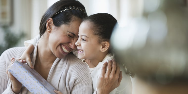 6e1b30870bf16 Hispanic girl giving mother birthday gift