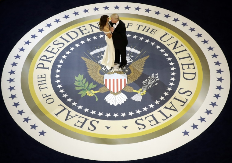 Image: President Donald Trump dances with first lady Melania Trump