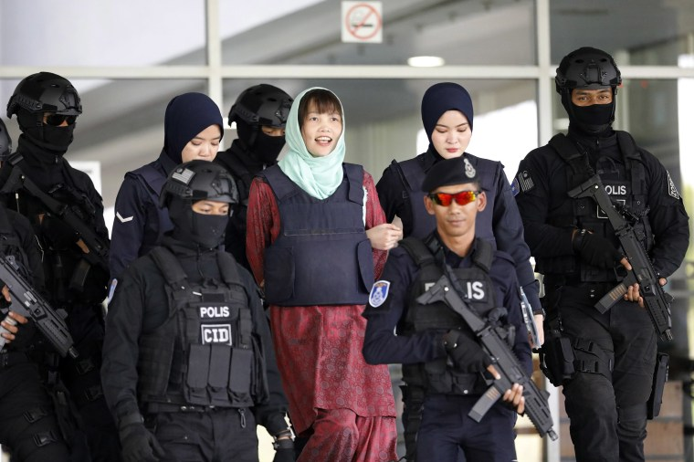 Image: Vietnamese Doan Thi Huong, center, is escorted by police as she leaves Shah Alam High Court in Shah Alam, Malaysia