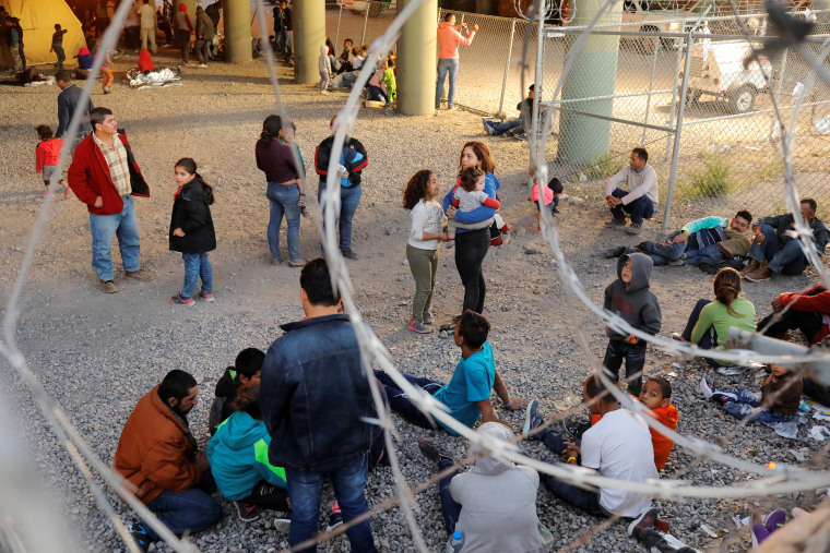 Image: Migrants from Central America wait inside of an enclosure, where they are being held by U.S. Customs and Border Protection (CBP), after crossing the border between Mexico and the United States illegally and turning themselves in to request asylum,