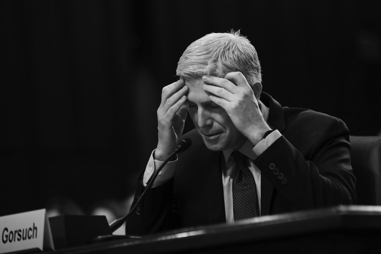 Image: Judge Neil Gorsuch pauses while testifying during second day of his Supreme Court confirmation hearing