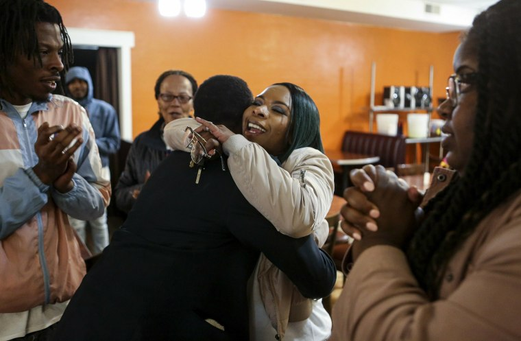 Image: Michael Brown's mother Lesley McSpadden embraces her brother Courtney McSpadden during McSpadden's election night watch party after losing the Ferguson City Council race at Sweetie Pie's in Dellwood