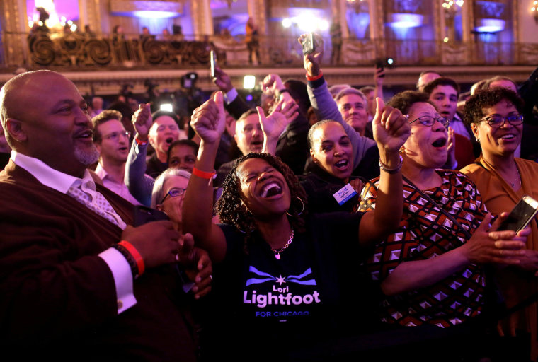 Image: Supporters celebrate mayoral candidate Lori Lightfoot's early election results at her election night celebration during a runoff election with challenger Toni Preckwinkle in Chicago