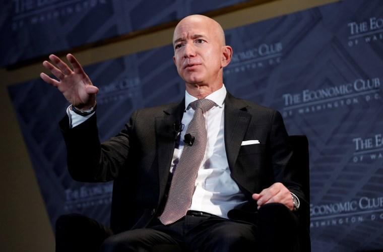"Image: FILE PHOTO: Jeff Bezos, president and CEO of Amazon and owner of The Washington Post, speaks at the Economic Club of Washington DC's ""Milestone Celebration Dinner"" in Washington"
