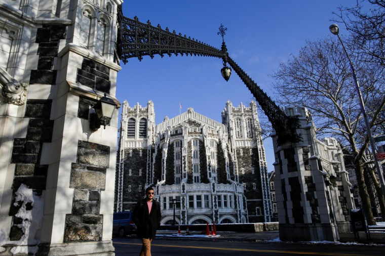 A man walks the campus of the City College of New York in the Harlem borough of New York