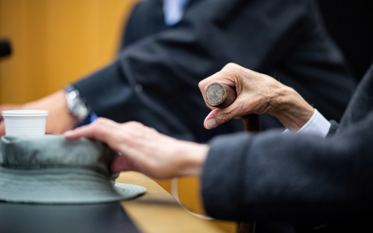 Image: A wheelchair-bound man appeared in court in Muenster, Germany, accused of helping to murder hundreds of people at a Nazi concentration camp during World War Two