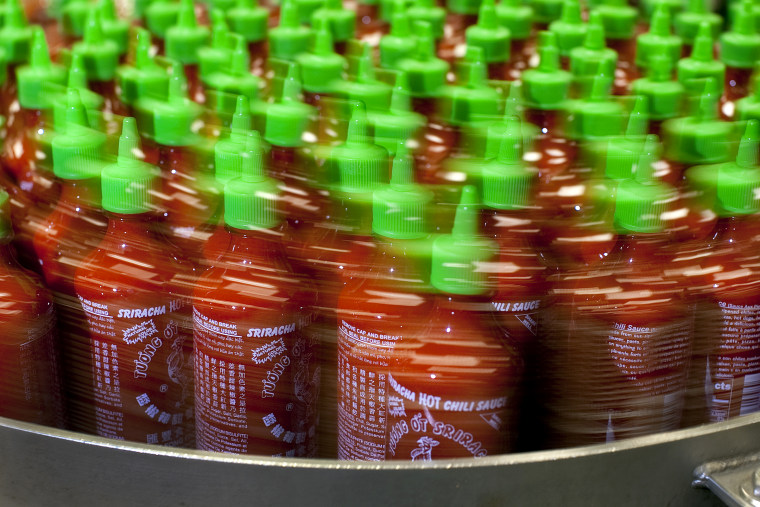Image: Sriracha bottles move through a conveyor belt for packaging at Huy Fong Foods in California in 2010.