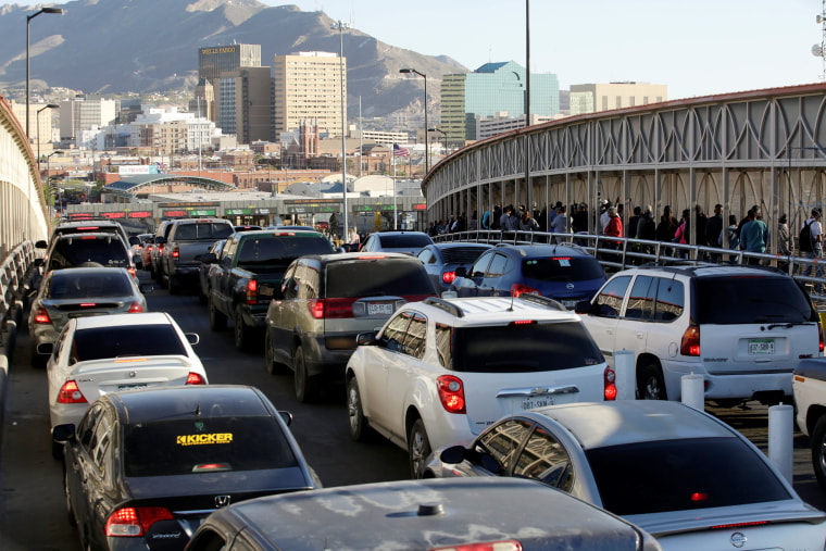 Image: Drivers and commuters wait in line to cross to El Paso, Texas, on the international border crossing bridge Paso del Norte, in Ciudad Juarez