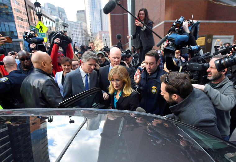 Image: Actor Felicity Huffman leaves the federal courthouse after facing charges in a nationwide college admissions cheating scheme in Boston