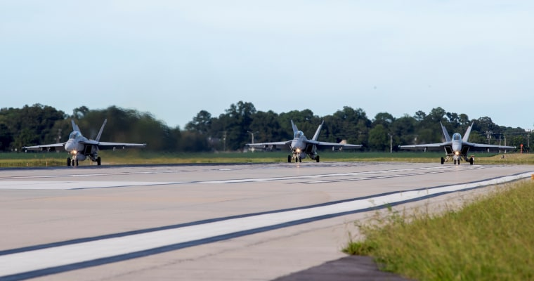 U.S. Navy jets prepare to depart Naval Air Station Oceana ahead of Hurricane Florence
