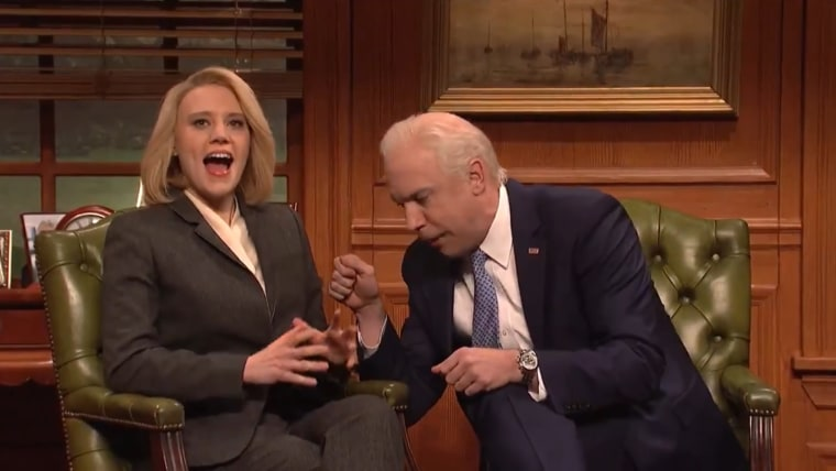 Former Vice President Joe Biden (Jason Sudeikis) and his sensitivity trainer (Kate McKinnon) go over proper protocol for greeting a female in SNL's cold open on April 6, 2019.