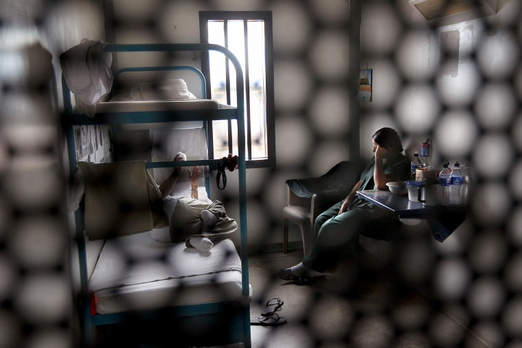 Image: Immigrants sit in a housing cell in the women's wing of a U.S. Immigration and Customs Enforcement detention facility in Eloy, Arizona, on July 30, 2010.