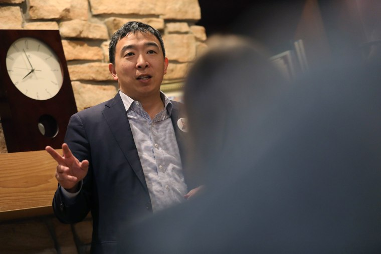 Image: U.S. 2020 Democratic presidential candidate Andrew Yang speaks at Potluck Insurgency, a local democratic activist event, at the home of one of its members in Iowa City, Iowa