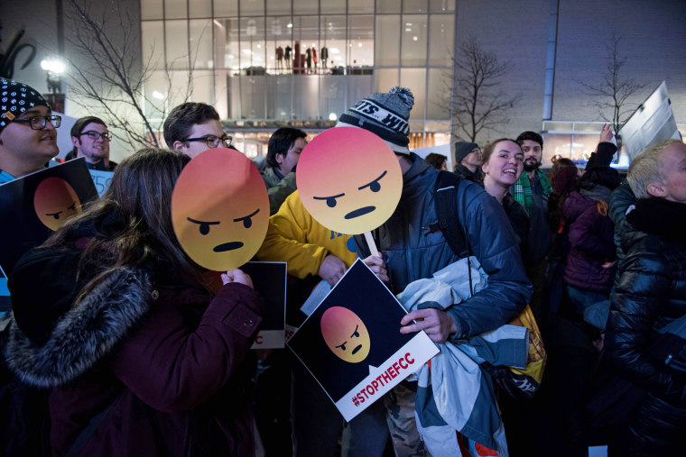 Image: Protesters gather on Bolyston Street in front of a Verizon store during a Net neutrality rally on Dec. 7 in Boston.