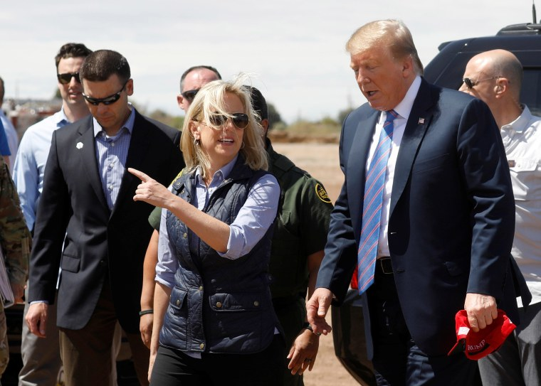 Image: Neilsen and McAleenan walk with Trump at border security tour in California