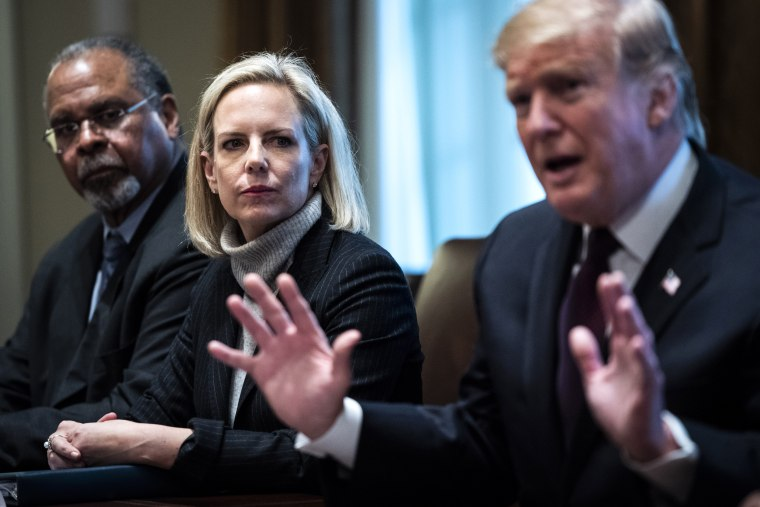 Image: President Donald Trump, flanked by Secretary of Homeland Security Kirstjen Nielsen, speaks during a meeting in the Cabinet Room at the White House on Jan. 23, 2019.