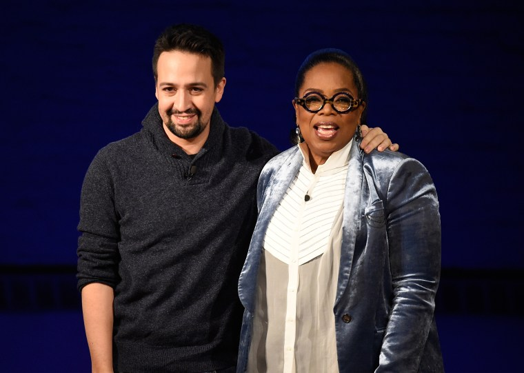 Image: Lin-Manuel Miranda and Oprah speak onstage at the Apollo Theater in New York on Feb. 7, 2018.