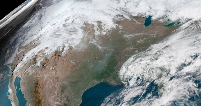 A satellite image from Tuesday morning shows a storm threatening the central U.S. with blizzard conditions.