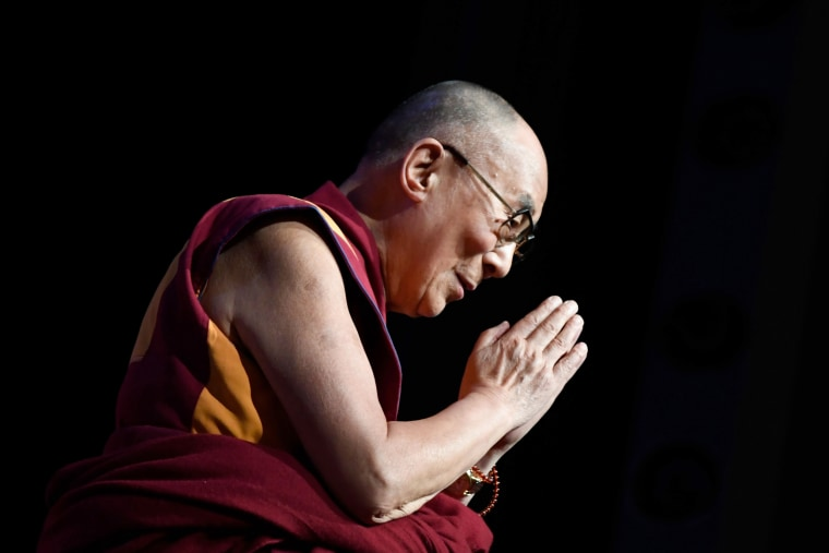 Image: The Dalai Lama gestures during a group hearing in Paris on Sept. 13, 2016.