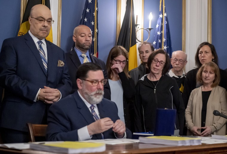 Image: Leigh Stein, daughter of victim Dan Stein, wipes away tears as Pittsburgh Mayor Bill Peduto signs three gun-control bills into law on April 9, 2019.