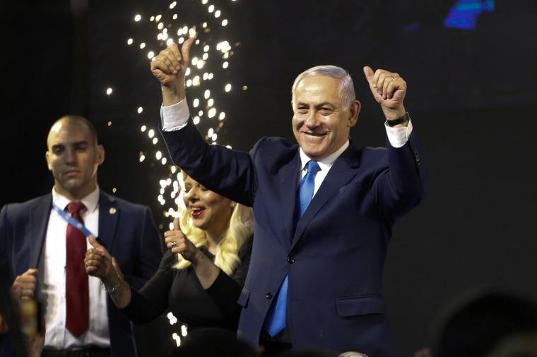 Image: Israel's Prime Minister Benjamin Netanyahu waves to his supporters after polls for Israel's general elections closed in Tel Aviv