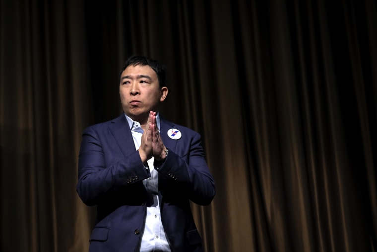 Image: Democratic presidential candidate Andrew Yang exits the stage after speaking at the National Action Network's annual convention in New York on April 3, 2019.