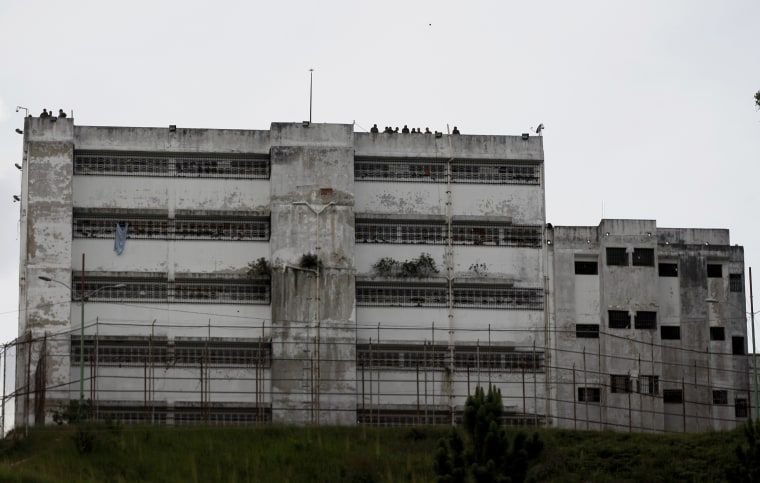 Image: Prison guards stand on the roof of the Ramo Verde military prison on the outskirts of Caracas, Venezuela, on April 28, 2017.