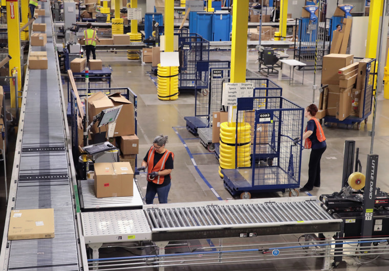 Workers pack and ship customer orders at a fulfillment center in Romeoville, Illinois, on Aug. 1, 2017