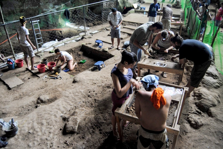 Image: The excavation crew at the Callao Cave in the north of Luzon Island, in the Philippines, where an international multidisciplinary team discovered a new hominin species, Homo Luzonensis, on Aug. 9, 2011.