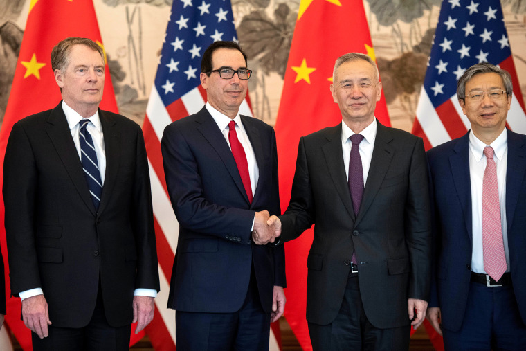 Image: China's Vice Premier Liu He shakes hands with U.S. Treasury Secretary Steven Mnuchin as Yi Gang, governor of the People's Bank of China (PBC) and U.S. Trade Representative Robert Lighthizer stand next to them, at Diaoyutai State Guesthouse in Beiji