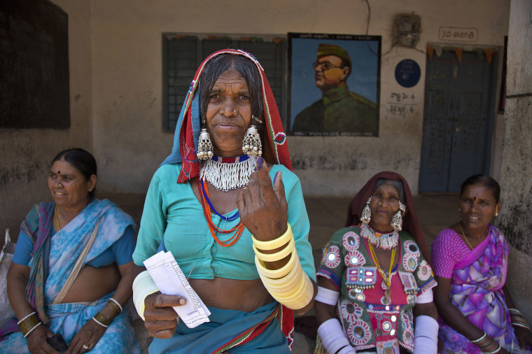 Image: An Indian Lambada tribal woman shows the indelible ink mark on her index finger after casting her vote at a polling booth during the first phase of general elections in Hyderabad, India