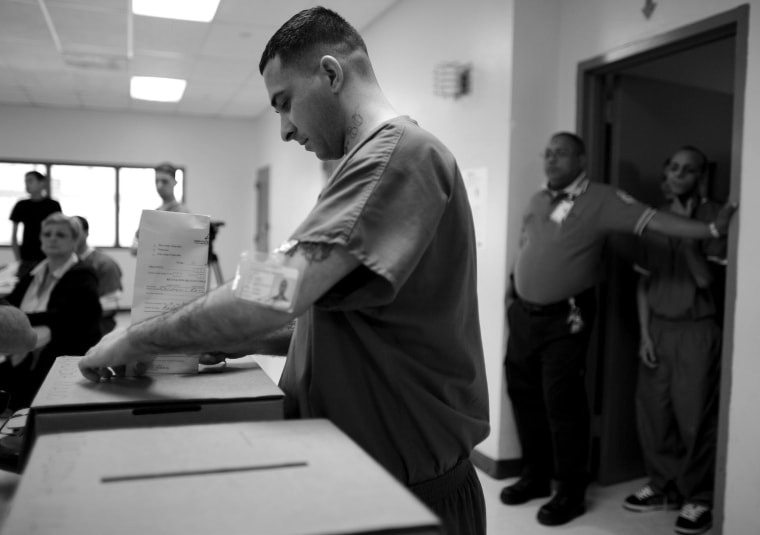 A Puerto Rican prison inmate casts his ballot, as prisoners voted two days early in the Democratic primary, at Correctional Institute 501, in Bayamon, Puerto Rico, on May 30, 2008.