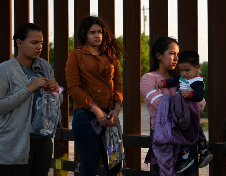 Image: Central American migrants turn themselves in to U.S. Border Patrol as they seek asylum after illegally crossing the Rio Grande near Penitas