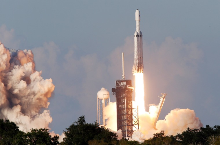 Image: A SpaceX Falcon Heavy rocket, carrying the Arabsat 6A communications satellite, lifts off  from the Kennedy Space Center in Cape Canaveral Florida