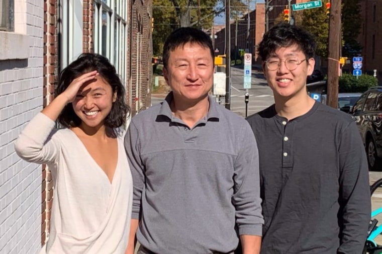 Kong Lee, center, the owner of Kaffeinate coffee shop in Durham, North Carolina.