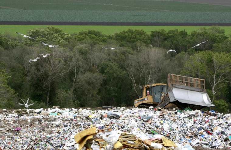 A bulldozer shifts garbage at the Monterey Regional Waste Management District landfill on Earth Day