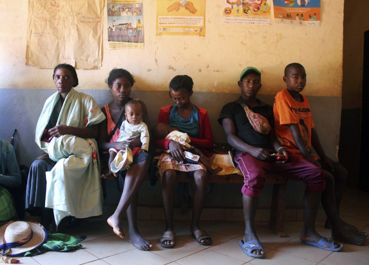 Image: Mothers wait to have their babies vaccinated against the measles at a healthcare center in Larintsena, Madagascar, on March 21, 2019.