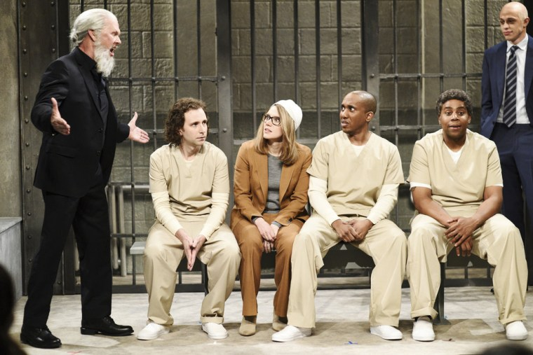 Image: Michael Keaton as Julian Assange, Kate McKinnon as Lori Loughlin, and Pete Davidson as Michael Avenatti during Saturday Night Live's Cold Open on April 13, 2019.
