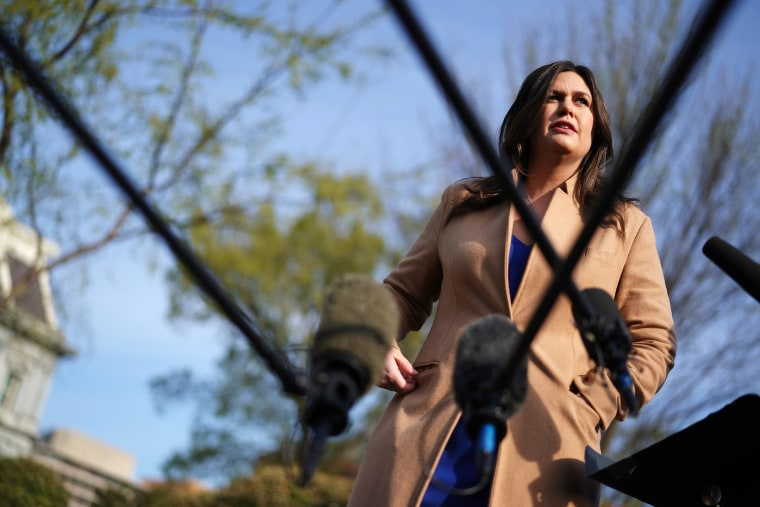 Image: White House Press Secretary Sarah Huckabee Sanders talks to reporters outside of the White House on April 4, 2019.