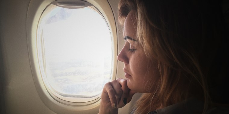 Close-Up Of Woman Traveling In Airplane