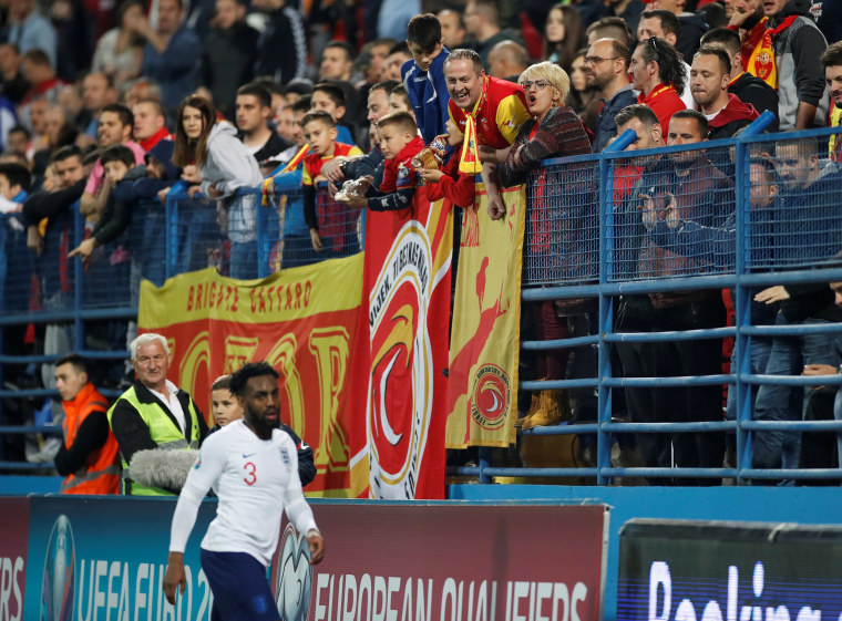 Image: Montenegro fans and England's Danny Rose during the match at Podgorica City Stadium, Podgorica, Montenegro