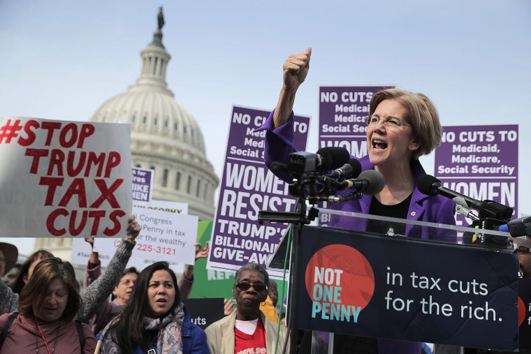 Image: Sen. Elizabeth Warren (D-MA) addresses a rally against the Republican tax plan outside the U.S. Capitol