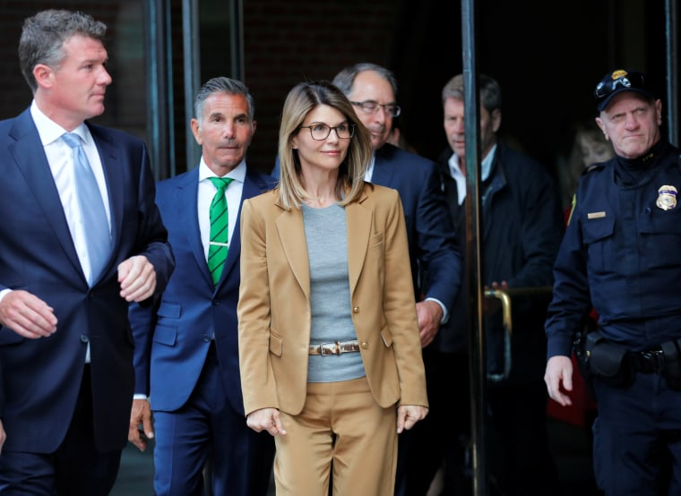 Image: Lori Loughlin and her husband, Mossimo Giannulli, leave federal court in Boston on April 3, 2019.