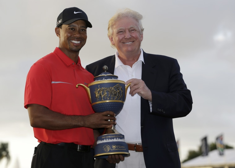 Image: Tiger Woods and Donald Trump pose for photos at the Cadillac Championship golf tournament in Doral, Florida, on March 10, 2013.