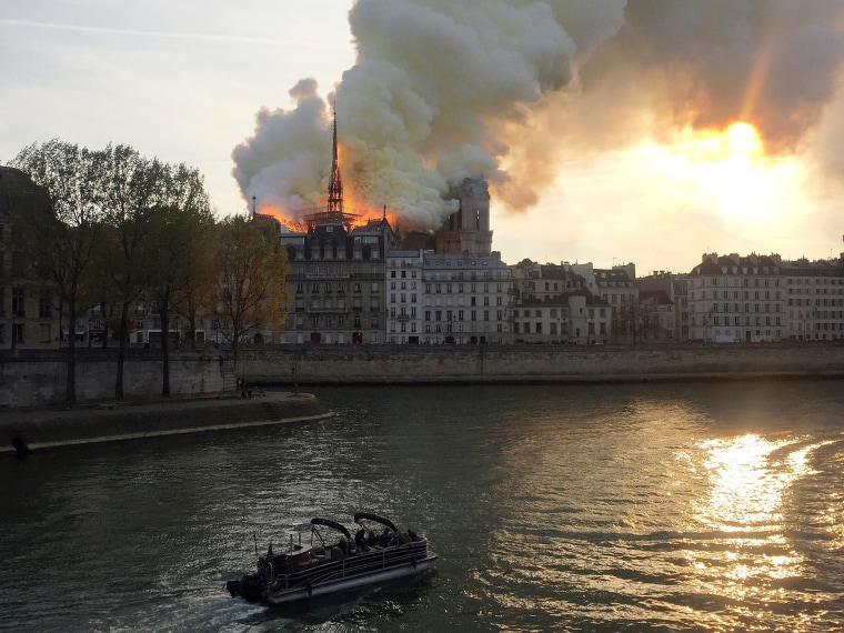 Image: Smoke billows from the Notre Dame Cathedral after a fire broke out, in Paris