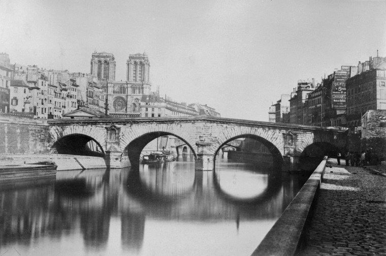 Image: The Saint-Michele Bridge near the Notre Dame Cathedral in 1857.