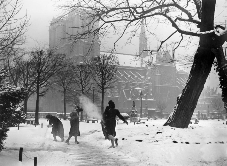 Image: Women play in the snow outside of the Notre Dame on Dec. 21, 1938.